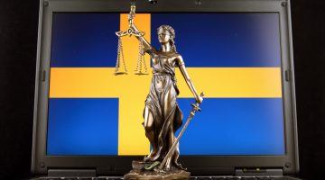 ymbol of law and justice with Sweden Flag on laptop
