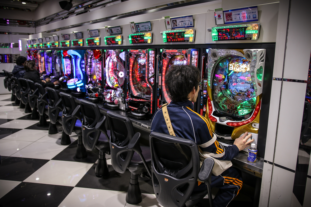 Pachinko arcade game and gambling. In Japan, people playing this game like a slot machine.